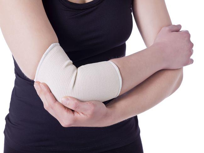 athlete woman having an elbow pain