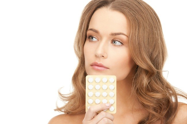 young beautiful woman with pills