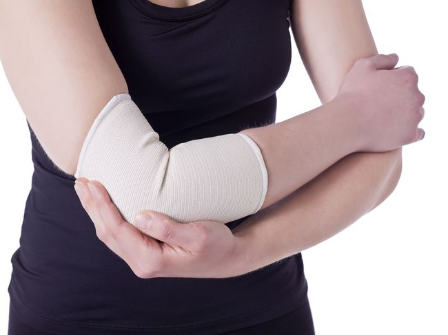 athlete woman having an elbow pain