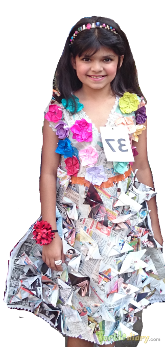 Dress made out of old News papers. Flowers and dress was made by Saachi herself. - Earth Day Contest April 2015 Submission