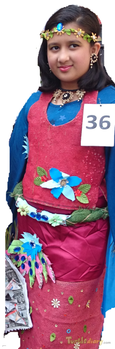 Devisha is wearing a dress made out of waste Jute bags . The dress is decorated with throw away articles and flowers. Belt is also made up of jute.  - Earth Day Contest April 2015 Submission