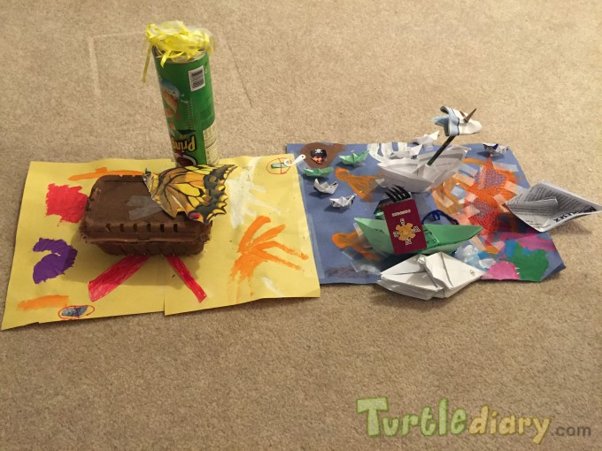 Model of sand and ocean with lighthouse, treasure chest, pirate ships, crabs and other ocean animals - all using recycled home materials - Earth Day Contest April 2015 Submission