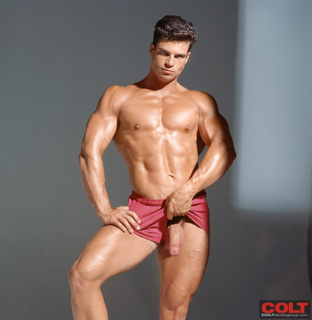 Classic Colt model Terry DeLong with his big dick coming out of his shorts (Colt Studio Group)