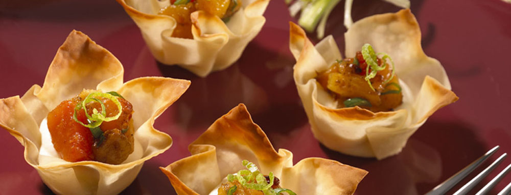 Photo of Won Ton Cups with Warm Passion Fruit Cream Cheese and Roasted Island Relish