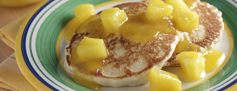 Photo of Tangy Mango Pineapple Sauced Pancakes