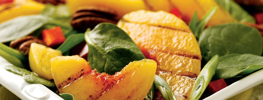 Photo of Spinach Salad with Grilled Peaches and Goat Cheese Toast