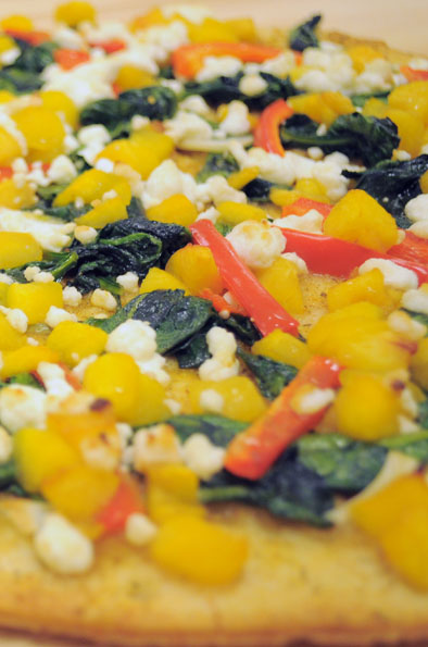 Photo of Spinach and Peach Pizza with Goat Cheese
