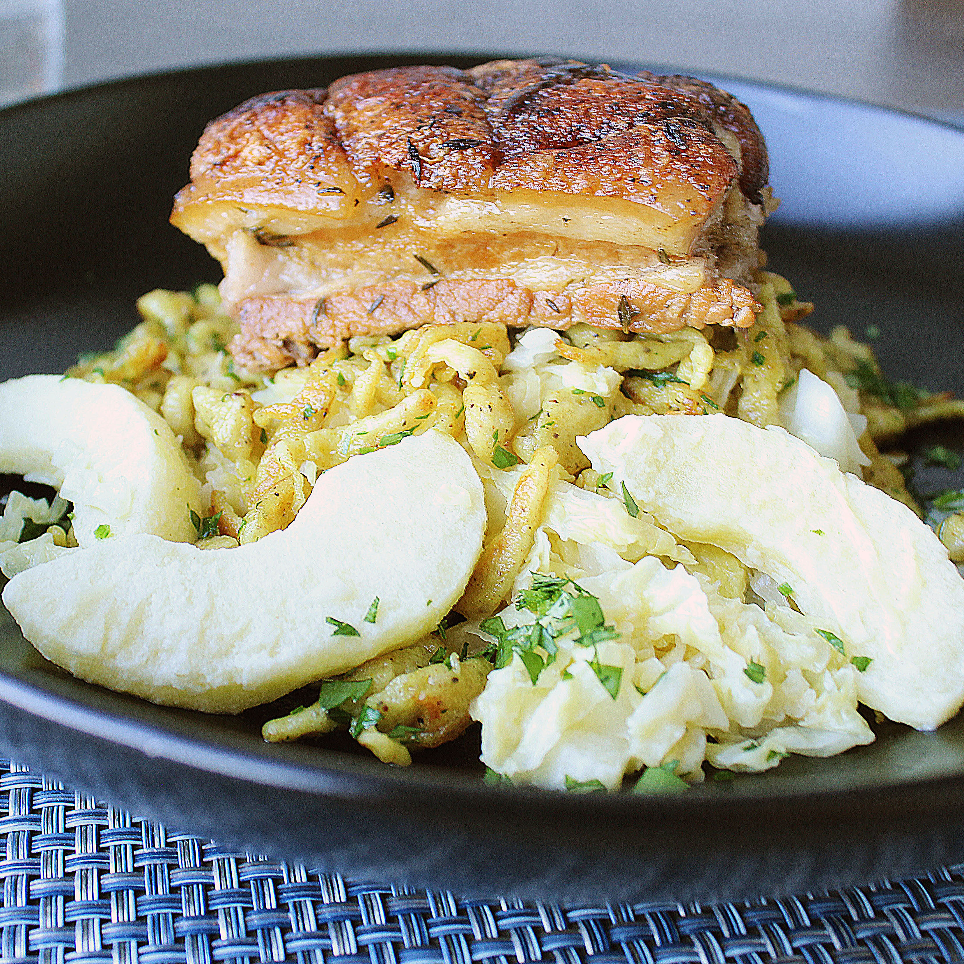 Pork Belly Bowl with Curried Spaetzle and Apple Cabbage Slaw