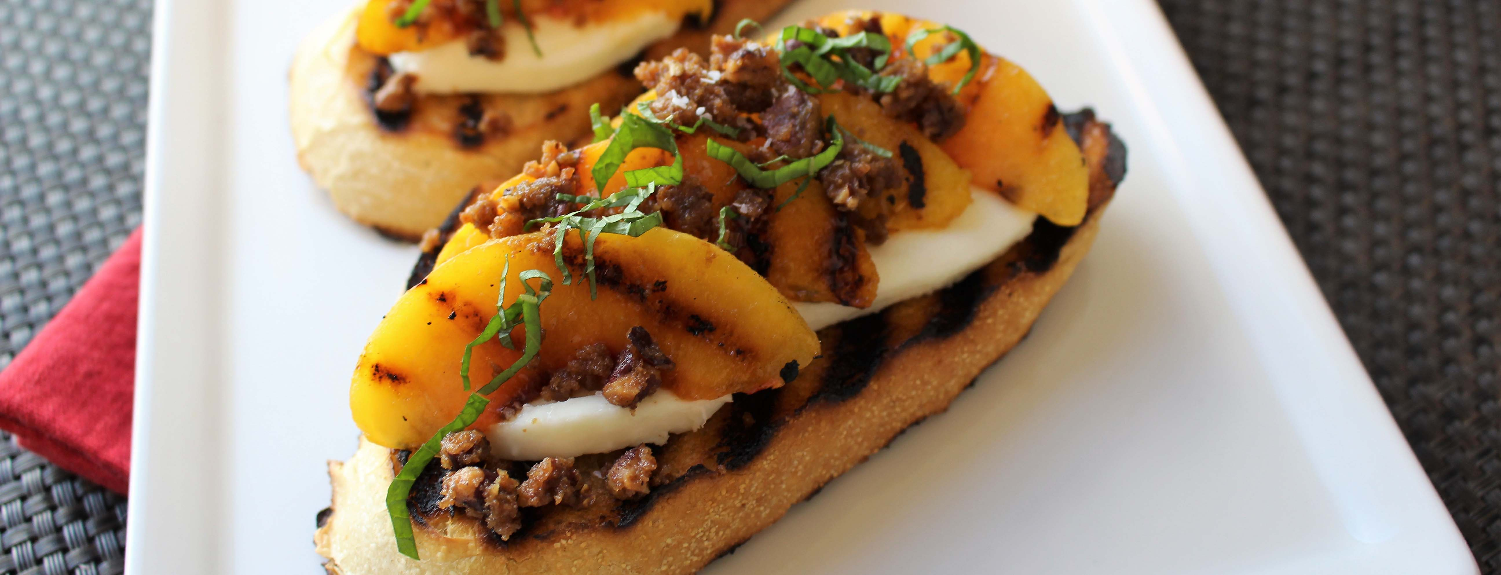 Photo of Grilled Peach Tartines with Burrata and Cardamom and Clove Crumble