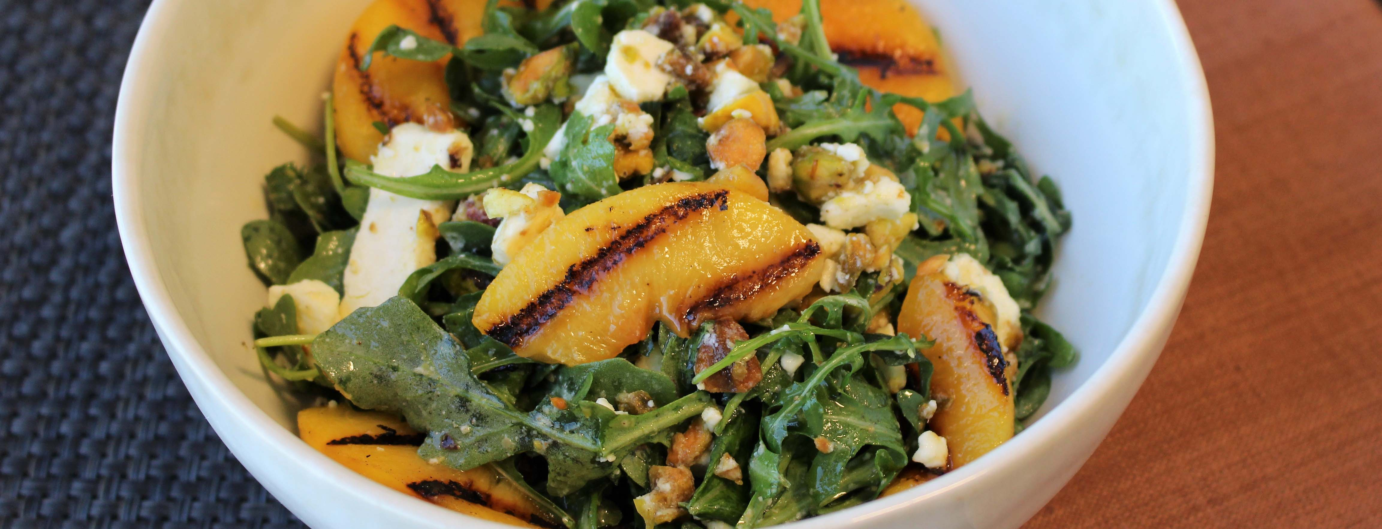 Photo of Grilled Peach and Arugula Salad with Cardamom and Clove Vinaigrette