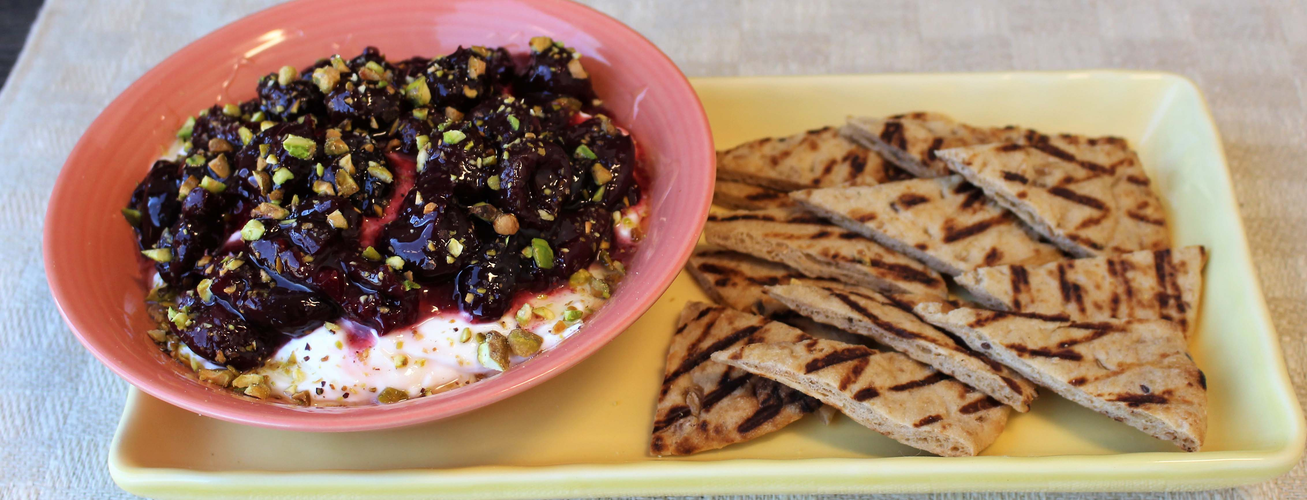 Photo of Labneh with Cherry Compote Toasted Pistachios and Honey with Flatbread Points