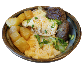 Savory grits bowl with sage sausage and caramelized pineapple