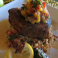 Blackened Catch of the Day with Cajun Rice Jalapeno Pineapple Pecan Chutney and Citrus Butter Sauce