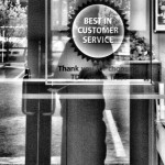 Photo of Customer Service Award In A Bank Window.