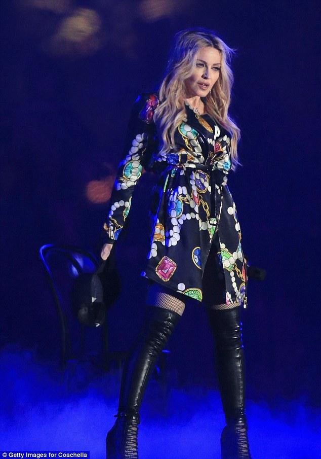 Surprise! Madonna reveals her T-shirt underneath a designer jacket