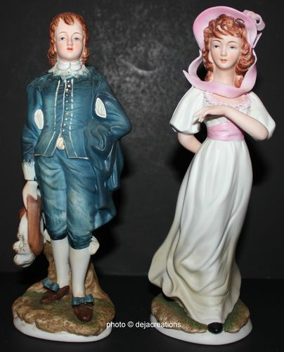 Blue boy and pink lady figurines