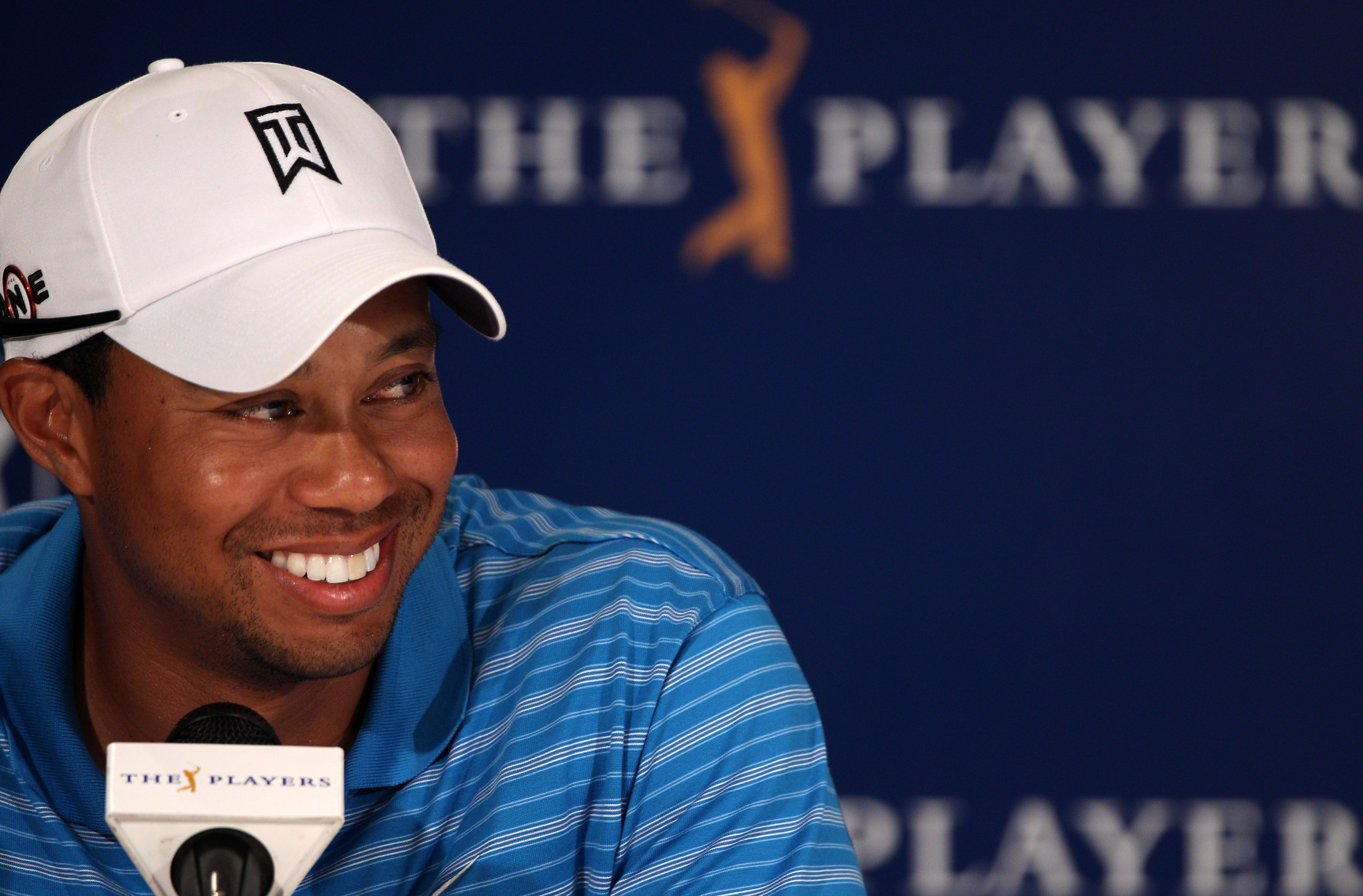 How old is tiger woods the golfer