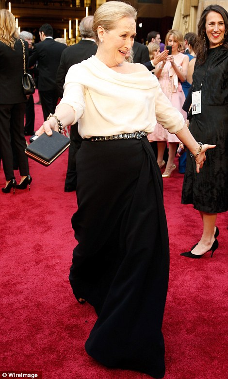 A delight in black and white: Meryl Streep sported a cream long sleeved top and maxi-skirt with belt for her big day