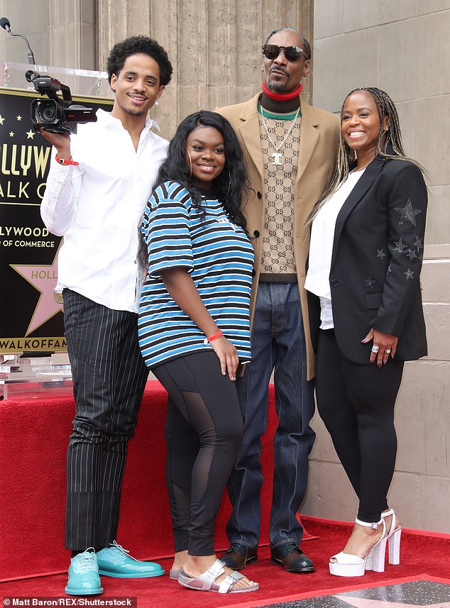 Doggfather:Snoop's loving family was also there to celebrate the big day