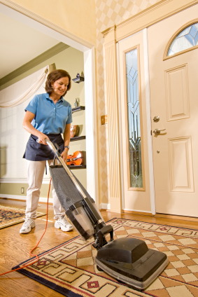 MBM Cleaning - maid vacuuming