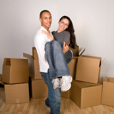 happy couple moving houses