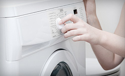 Tristate Refrigeration Appliance & Service Repair - Technician Turning Knobs On Washing Machine
