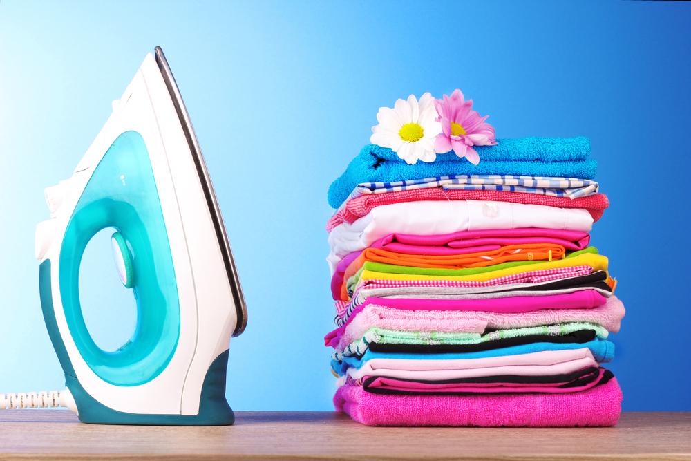 Laundry Service folded laundry with iron