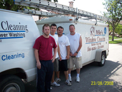 Mike's Window Cleaning and Gutter Service - crew in front of truck