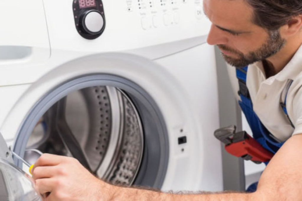 Hudson Appliance Repair & Removal - Working on a Broken Washer