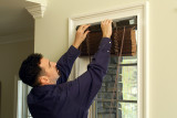 Top Notch Shutters - Man installing blinds