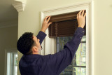 Top Notch Shutters - Man Installing Blinds 2
