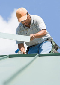 Allen Roofing & Siding Company, Inc. - Man Installing Metal Roof