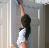 MBM Cleaning, Inc. - Cleaning a door frame