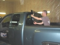 Audio House Napa: window tint being  installed on a truck