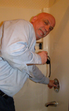 Advanced Rooter Plumbing -Owner working on shower plumbing