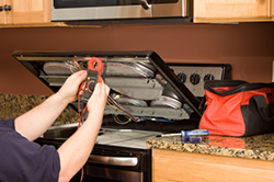 Mamaroneck Appliance & Services, Inc. - Fixing a stove