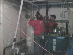 Airco Home Comfort Services- Working on a broken furnace