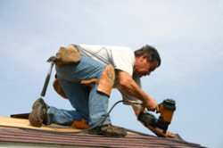 Allen Roofing & Sheet Metal Inc. - Man Replacing Roof