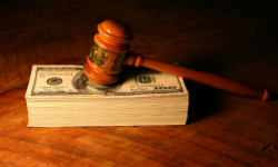 David B. Newman, LLC - Gavel and stack of money