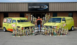 Extreme Car Audio - Competition car audio van in front of store with trophies