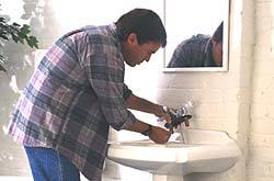 Fusion Plumbing - Professional working  on sink