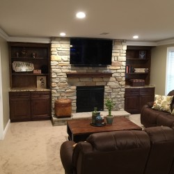 Pro Basement Finishers - Finished basement with fireplace