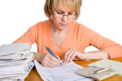 Acello Tax Resolution Group - Woman reviewing taxes