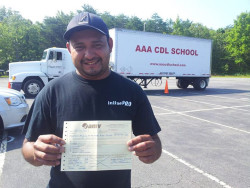 AAA CDL SCHOOL - Student holding truck driving license