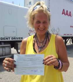 AAA CDL SCHOOL - Student holding up Class B license