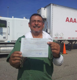 AAA CDL SCHOOL -Student holding commercial driving license