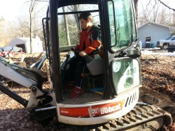 Son on Excavating Equipment