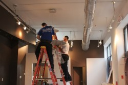 AllStar Electrical Services - Installing a ceiling light