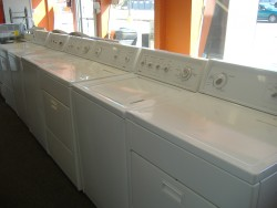Mass Appliance service - Used washer and dryers - Pile of Trash