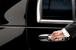 A & J Transportation Service - Chauffeur opening the car door
